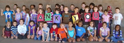 Kids with Thank you sign