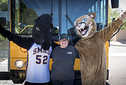 Bus driver with school mascots
