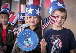 Elementary students in uncle sam hats wave American flags