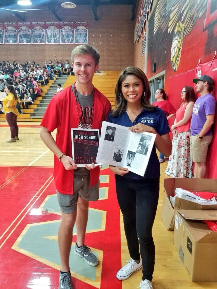 Senior Nathan Kuban presenting a copy to 3TV/CBS5 reporter and Ironwood Alumni Maria Hechanova.