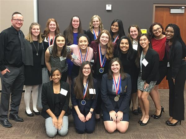 Liberty DECA Students Compete at District Competition & Bring Home Twelve Medals