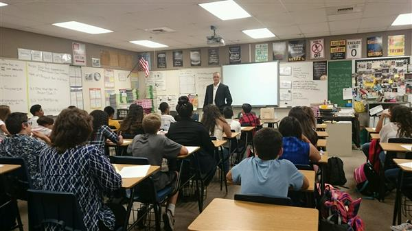 Flip Flippen Meets with 7th grade students